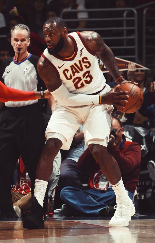 "2be59bb00146 WASHINGTON — LeBron James wore one black Nike basketball shoe and one white  with the word ""Equality"" on the back of each shoe — the LeBron 15 Equality  PEs ..."